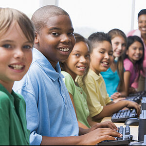School children using computers supplied by 'TAP'