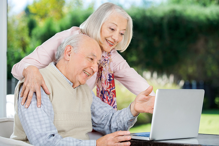 Woman and Man at a laptop computer